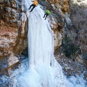 Rappelling a frozen waterfall scenery Arizona canyoneering ice canyon